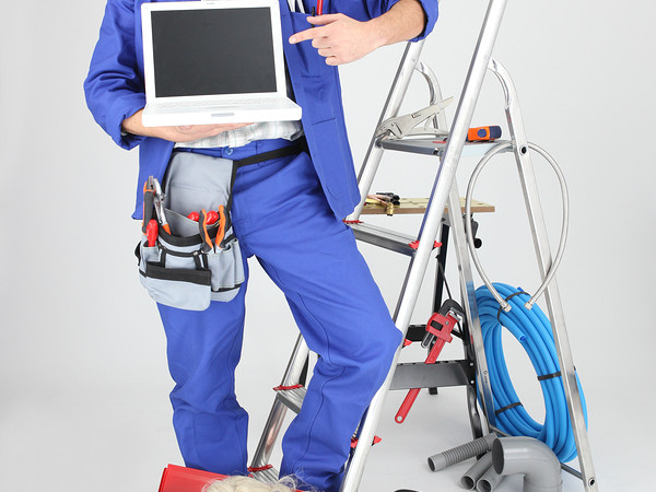 bigstock-Electrician-with-computer-and-22982351-2